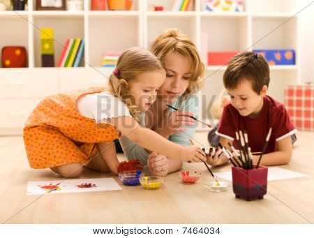 Kids Painting Hands With Their Mother