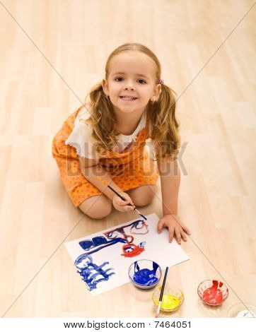 Happy Girl Painting Sitting On The Floor