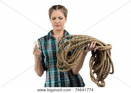 Photo of young woman with the soap and twine