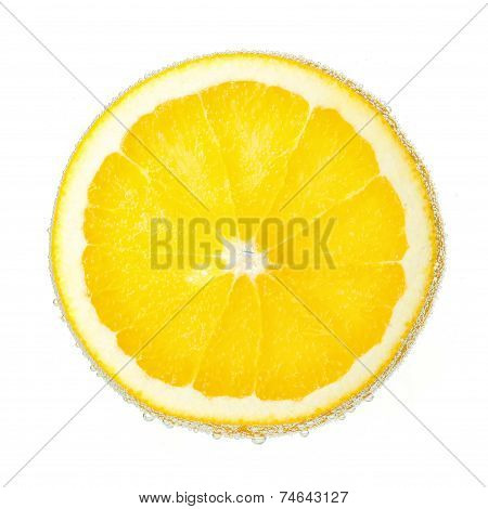 Nice ripe and juicy slice of an orange covered with bubbles. Isolated on white.