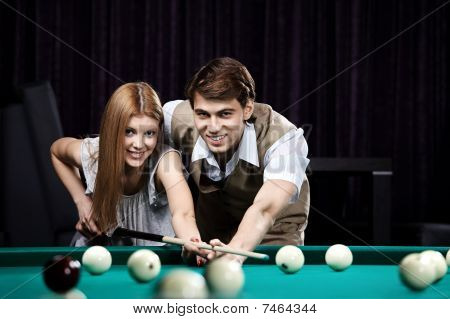 Happy Couple In A Billiard Room