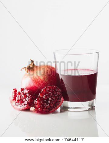 Pomegranate and glass of pomegranate juice