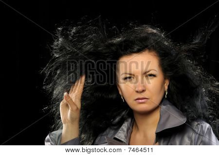Model With Beautiful Long Hair In Motion Created By Wind