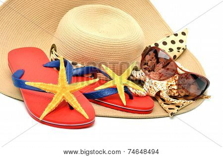 Red Flip Flops With Starfishes, Sunglasses And A Seashell Isolated On White