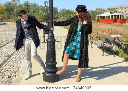 Outdoor Lifestyle Portrait Of Young Retro Couple In Love