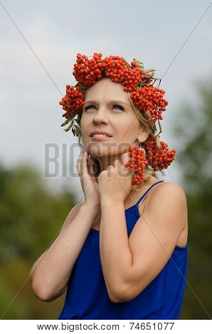 Young woman with rowan crown