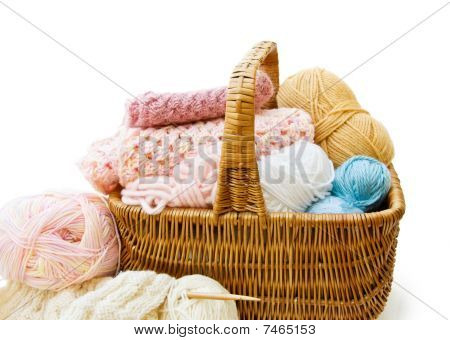 Knitting basket with yarn and needles