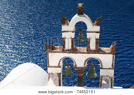 Ancient Bell Tower Over The Blue Sea