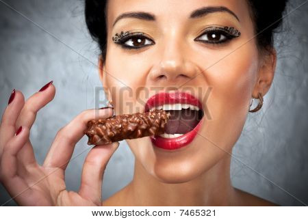 Young Woman Eating Sweet