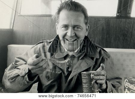 ITALY - CIRCA 1970s: Vintage photo shows man eating canned food.