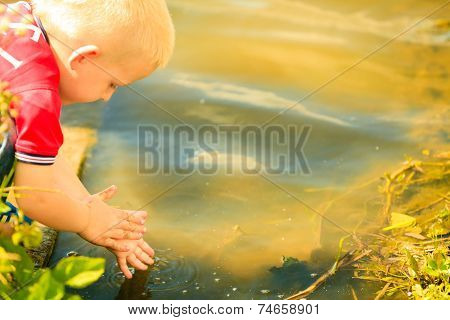 Little Boy Playing Playing With Water Outdoor Washing Hands