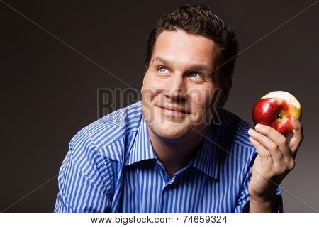 Diet Nutrition. Happy Man Eating Apple Fruit