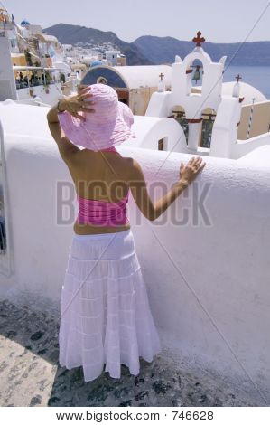 Attractive Young Greek Woman On The Streets Of Oia, Santorini
