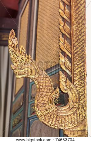 Detail of Carved Naka in Thai temple
