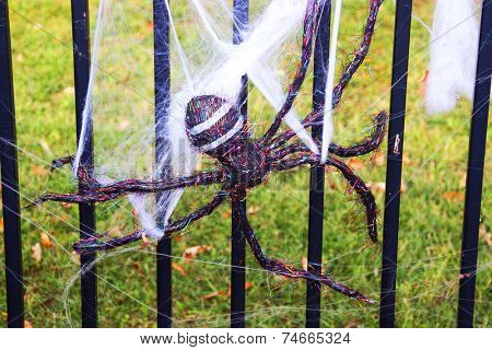 Fake spider on a metal fence
