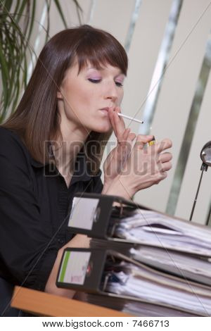 Female Smoking In Office