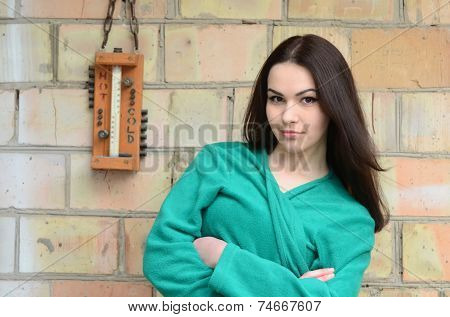 Teen girl with outdoor thermometer.Near Kiev,Ukraine. Winter coming