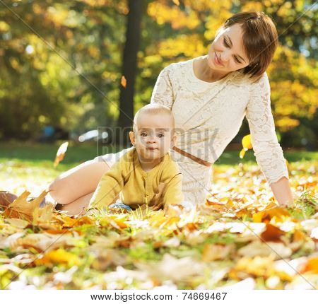 Mother and baby relaxing in the park