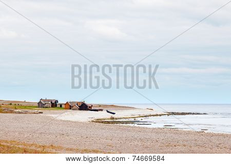Shoreline of Gotland, Sweden with beach, water and fishing huts