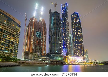 ABU DHABI, UAE - 25 MARCH 2014: Etihad Towers buildings in Abu Dhabi, United Arab Emirates. Five towers complex with 74 floors is the third tallest building in Abu Dhabi.