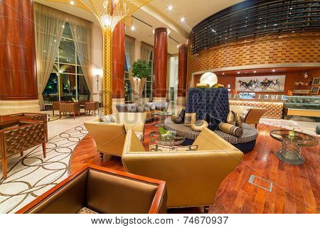 ABU DHABI, UAE - 26 MARCH 2014: Lobby and hall of Khalidiya Palace by Rotana, United Arab Emitares. Rotana Hotel Management Corporation has 85 properties in 26 cities around Middle East and Africa.