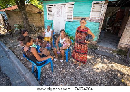 Unidentified local family enjoying midday siesta in village near Barahona