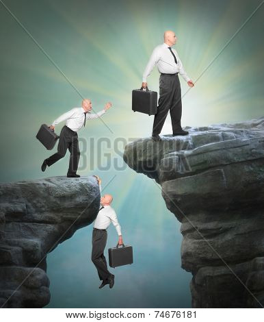 Businessmen climbing on a cliff. Competition and success in business metaphor.