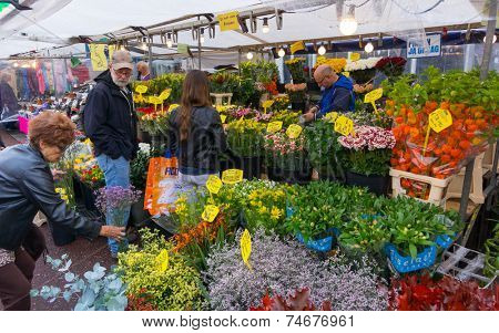 AMSTERDAM - AUGUST 30: People buy flowers at the flower market on August 30, 2014 in Amsterdam.