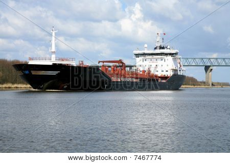 Oil tank. Ship with cargo on the Kiel Canal, Germany.