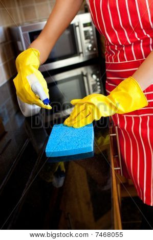 Close-up Of A Caucasian Woman Doing Housework