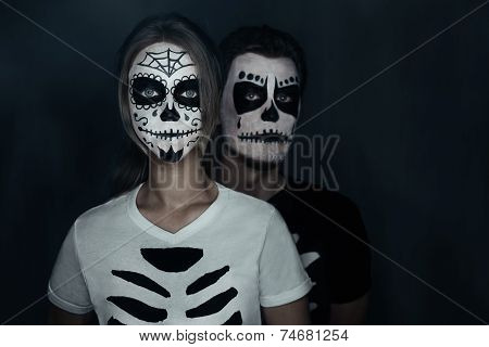 Couple In Costumes Of Skeletons