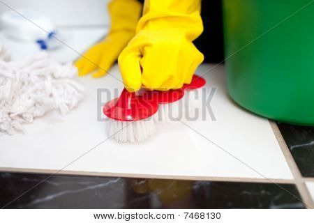 Woman Cleaning A Bathroom's Floor