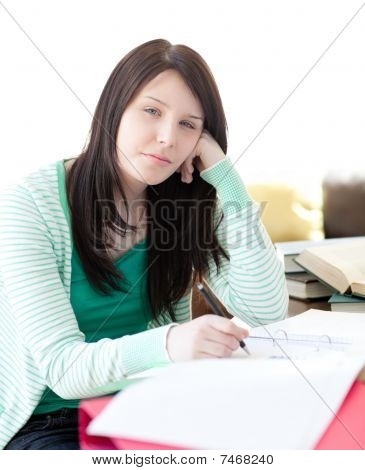 Tired Attractive Student Sleeping While Doing Her Homework