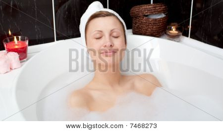 Charmng Woman Relaxing In A Bubble Bath