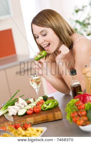 Cooking - Happy Woman Biting Slice Of Green Pepper