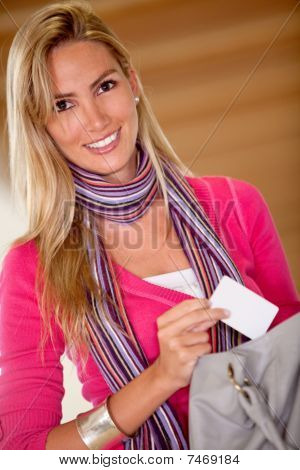 Woman Taking A Card From Her Purse
