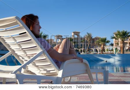 Woman Relaxing At Resort Hotel