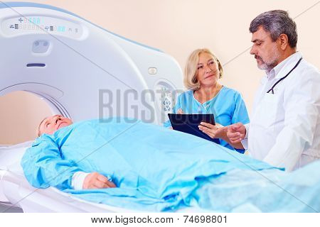 Doctor Instructing Medical Staff About Ct Scanner Procedure