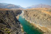 stock photo of oman  - Water has cut through desert rock to create Wadi Dyqah one of the most beautiful natural landscapes in the Sultanate of Oman - JPG