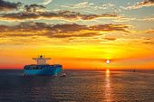 pic of container ship  - Container ship on sea road during sunrise - JPG