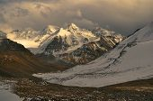 image of karakoram  - Scenic view of cloudy Wakhan valley in Tajikistan with snowy mountain peaks of Pamir and Karakoram - JPG