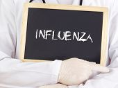 stock photo of influenza  - Doctor shows an information on blackboard - JPG