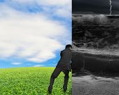 stock photo of wall cloud  - businessman pushing away stormy sea wall with nature sky clouds grass - JPG