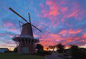 foto of windmills  - De Molen windmill of Foxton New Zealand with a wonderful sunrise sky over it - JPG