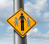 picture of child missing  - Child custody loss concept as a traffic sign with a father and two of his missing children as a family law symbol of social issues caused by divorce and separation - JPG