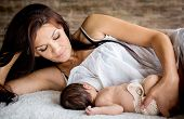 foto of child feeding  - beautiful mother feeding her newborn with breast - JPG