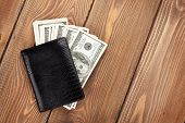 image of cash  - Money cash wallet on wooden table with copy space - JPG