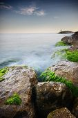 pic of long distance  - Nice long exposure seascape with a fisherman in a distance - JPG