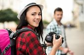 picture of she-male  - Woman is taking picture of boyfriend on tourist journey - JPG