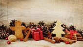 pic of walnut-tree  - Christmas various gingerbread cookies with red gift christmas tree santa claus stick scene on wooden surface - JPG
